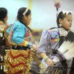 10-year-old Ontario, Canada resident Adrianna Douglas, right, of the Six Nations tribe, dances the jingle dress side-step during the Dance for Mother Earth Powwow at Saline Middle School in Saline, Mich. on March 19th, 2011.  Angela J. Cesere | AnnArbor.com